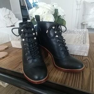 Lace up black leather heeled boots